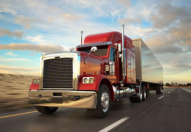 tdg-category-semi-truck-driving-down-road